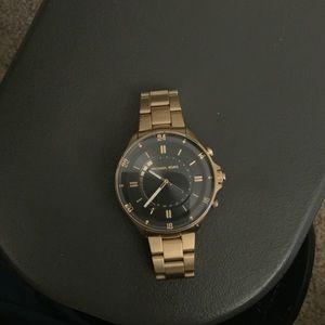 Men's gold Michael kors smartwatch watch